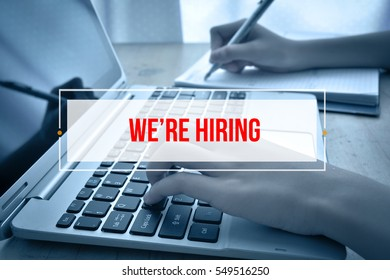 Hand Typing on keyboard with text WE'RE HIRING