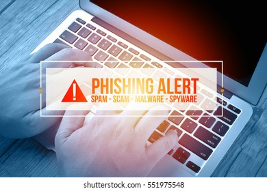 Hand Typing on keyboard with text PHISHING ALERT