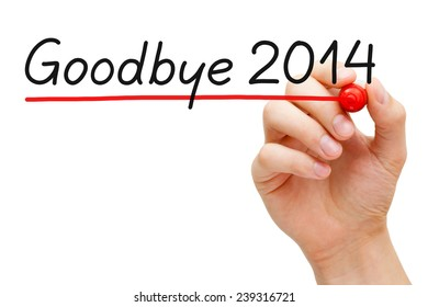 Hand underlining Goodbye 2014 with red marker isolated on white background.