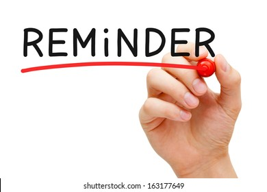 Hand underlining Reminder with red marker on transparent wipe board.