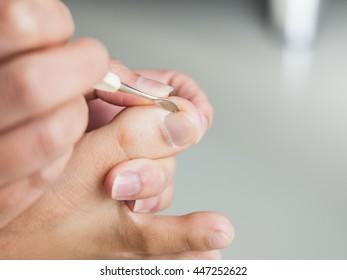 Hand use a nail file to clean toenail
