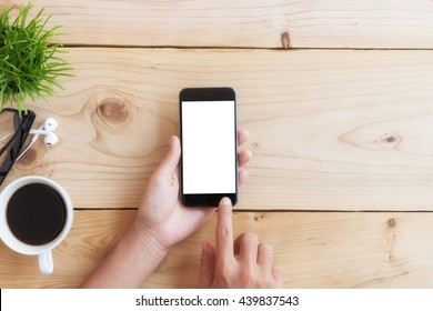 hand use phone white screen on wood table