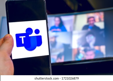 hand use videoconference app icon of Microsoft Teams on smartphone in Bologna, Italy, 03 May 2020