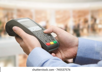 Hand using credit card payment machine. card machine terminal payment credit shop reader pay concept