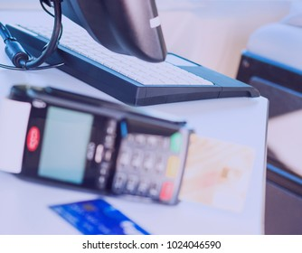 Hand using a credit card terminal machine for payment in the dining room and supermarket, calculation on the Internet.
