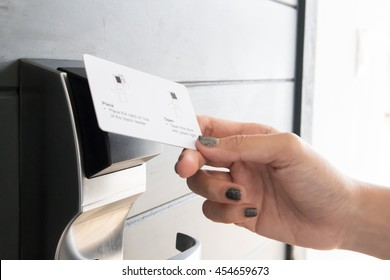 Hand Using Key card to Get into Room