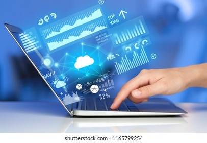 Hand using laptop with cloud technology and linked information concept
