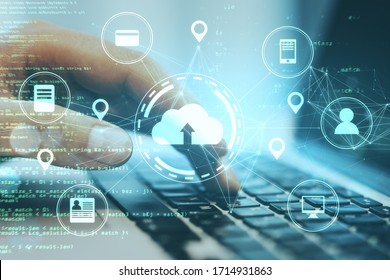 Hand using laptop with online shopping and cloud computing diagram. Cloud computing and communication concept.
