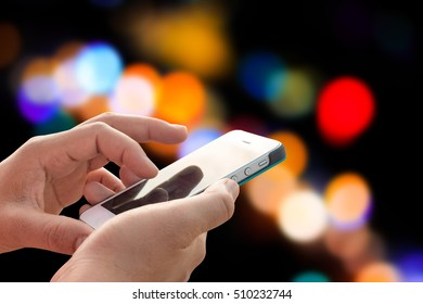 Hand using mobile phone on blurred background
