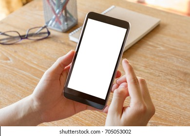hand using mobile smart phone with blank white screen on office desk - clipping path inside