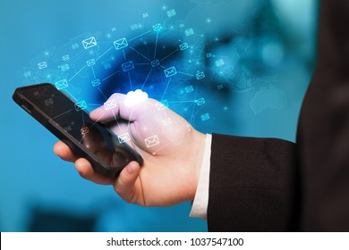 Hand using phone with cloud computing and online storage concept