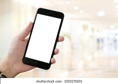 Hand using smart phone over blur bokeh light background, mock up, business and technology, internet of things concept
