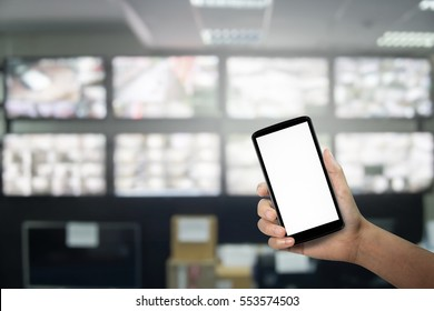 Hand using a smartphone with white screen at cctv blurred background