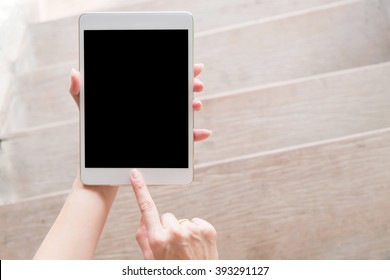 hand using tablet on top view. Clipping path included.