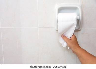Hand Using Toilet Paper. diarrhea constipation .Health concept