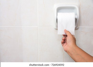 Hand Using Toilet Paper in toilet. diarrhea constipation.Health concept