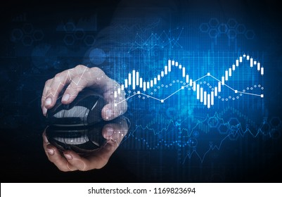Hand using wireless mouse with statistical concept on dark background