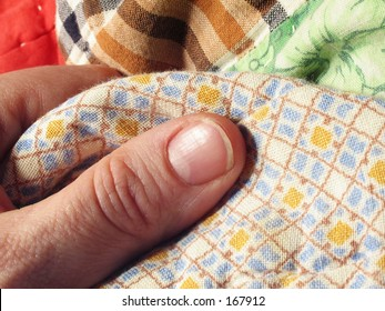 hand with vintage quilt