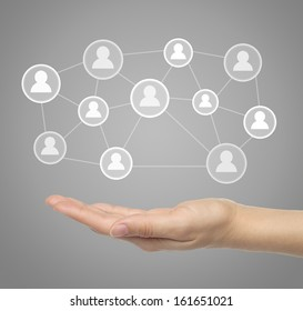 Hand with virtual social media icons
