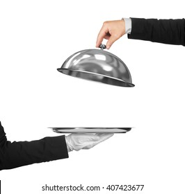 The hand of the waiter holding cloche over empty tray on an isolated white background. Concept of First Class Service on white background