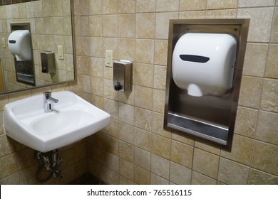 Hand wash sink and dryer blower in public restroom