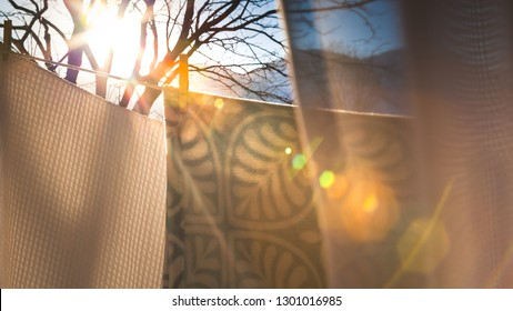 Hand Washed Blankets Hanging On A Clothesline Outside Drying In The Late Afternoon Sun