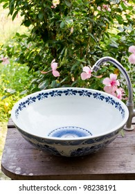 Hand washing basin in the garden, antique and retro style