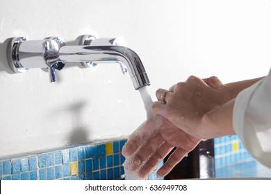 Hand washing in the bathroom at home,water sinks.