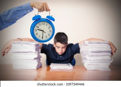 hand with watch and child studying at the desk or school