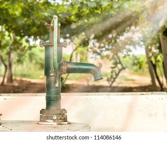 Hand water pump in the vineyard