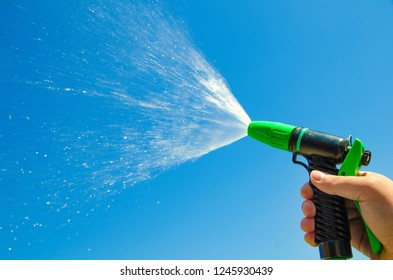 hand with water spray jet