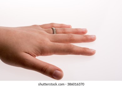 Hand wearing a ring on a white background