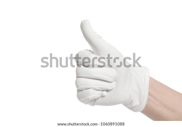 Hand wearing white glove showing Thumbs up signal isolated on white
