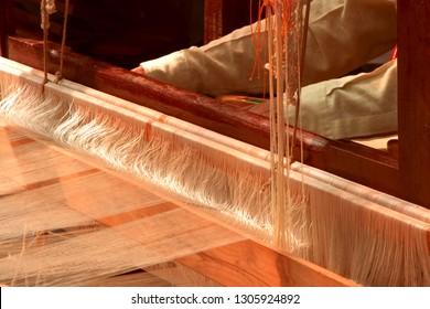 hand weavers using machine and spinning tools