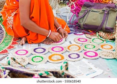 Hand weaving of jute coasters, handicrafts on display during the Handicraft Fair in Kolkata. Biggest handicrafts fair in Asia.