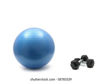 Hand weights and a fitball isolated against a white background