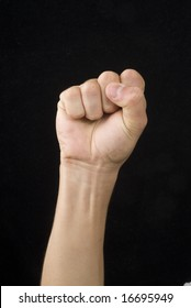 A hand whit victory signal in a black back