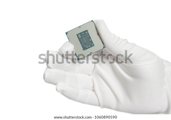 Hand in white glove holding a CPU computer processor microchip  isolated on white