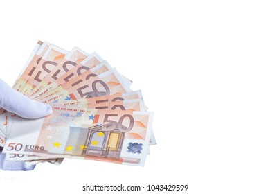 A hand with a white glove placed holds five hundred euros isolated on white.