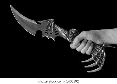 A hand wielding a knife