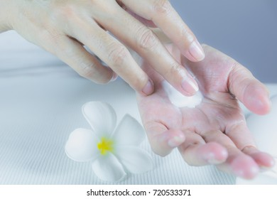hand of woman apply lotion on skin of hand