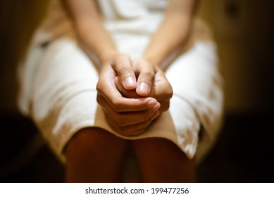 Hand of woman in bath towel sitting on toilet bowl , pain form hemorrhoids or Constipation symptom