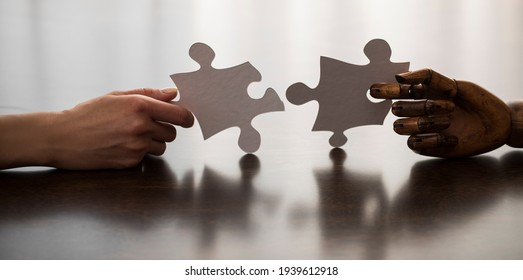hand of woman connecting jigsaw puzzle. Business solutions, success and strategy concept