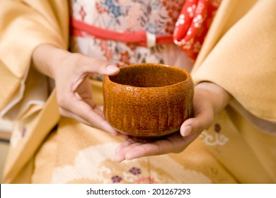 Hand of a woman with a cup