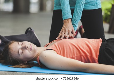 Hand of woman gesture CPR Patients with unconsciousness or heart failure. After exercise on city background. resuscitation (first aid) and rescue CPR training to save life concept