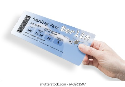 Hand of a woman holding a airplane ticket to Berlin (Europe-Germany) - image isolated on white. The image background with the sky and the airplane are a picture of my property.