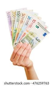 Hand of woman holding fan of Euro money bills