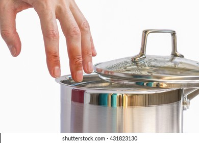 Hand of woman with injuries above pot with boiling water, burns of skin,  home accident, careless behavior with boiling water and hot steams, scalds on a skin,  aching womanâ??s fingers