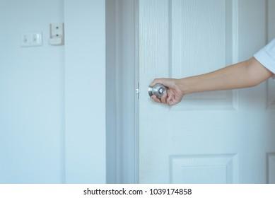 Hand woman open door room,Door knob