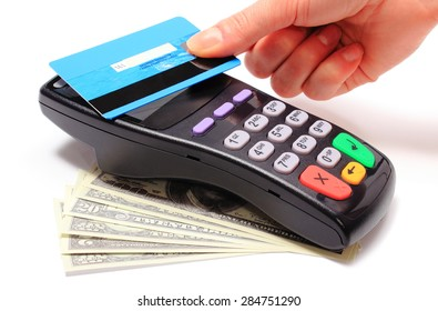 Hand of woman paying with contactless credit card with NFC technology, credit card reader, payment terminal and cash, finance concept